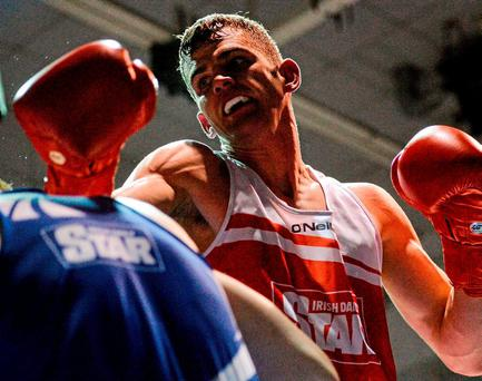 Adam Nolan advances on Michael Bustard in his National Championships welterweight semi-final victory