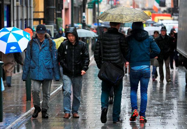 Members of the public brave the bad weather on Grafton Street, Dublin. Photo: Gareth Chaney Collins