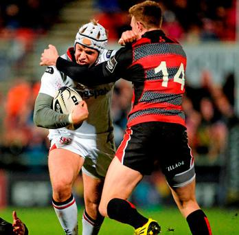 Ulster's Luke Marshall is tackled by Edinburgh's Dougie Fife