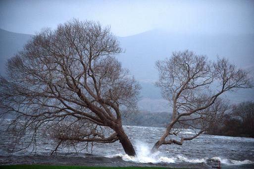 Storm Desmond arrives on Lough Lein in Killarney, Co Kerry, flooding part of the fairway on the first hole at Killarney Golf Club. Photo: Don MacMonagle