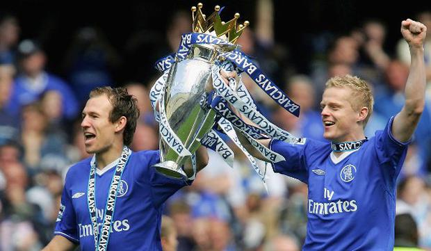 Arjen Robben and Damien Duff celebrate winning the Premier League title