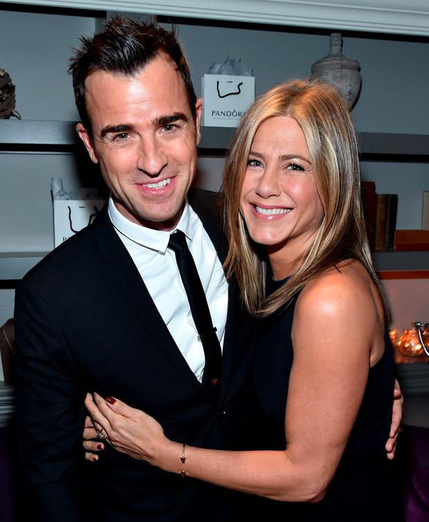 Actor Justin Theroux (L) and actress/executive producer Jennifer Aniston attend the