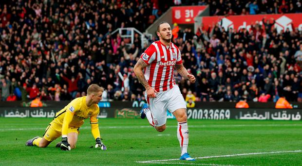 Marko Arnautovic celebrates scoring against Manchester City