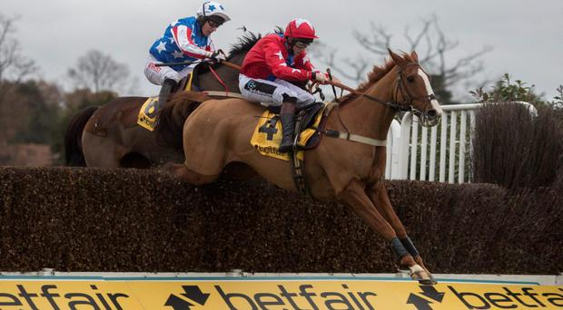 Sire De Grugy ridden by Jamie MooreLeads Special Tiara ridden by Noel Fehily over the last fence before going on to win the The Betfair Tingle Creek Steeple Chase Race