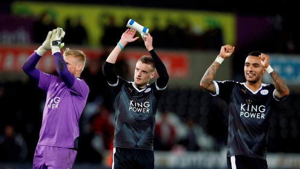 Leicester City's Kasper Schmeichel, Jamie Vardy and Danny Simpson celebrate after the game