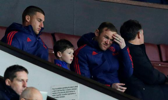 Manchester United's Wayne Rooney with son Kai and Sam Johnstone sat in the stands