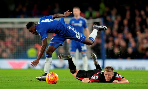Bournemouth's Matt Ritchie and Chelsea's Baba Rahman in action
