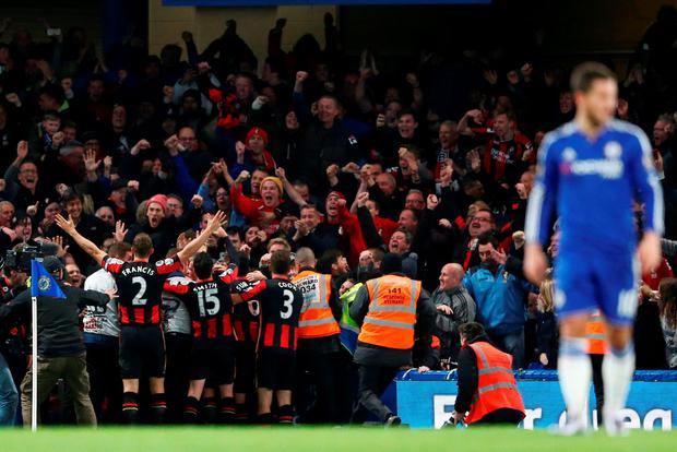 Bournemouth's Glenn Murray celebrates with teammates and the fans