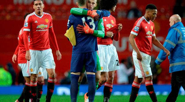 Manchester United's Spanish goalkeeper David de Gea greets West Ham United's Spanish goalkeeper Adrian
