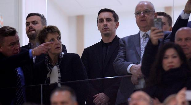 Valencia's head coach Gary Neville, center, in the stands before a Spanish La Liga soccer match against Valencia at the Mestalla stadium in Valencia, Spain, Saturday, Dec. 5, 2015. Salvador Gonzalez Voro had been appointed as interim coach with Garys brother Phil as his assistant following Nunos departure. Neville will officially take charge on Sunday, the day after Valencia's clash with Barcelona and before their Champions League clash with Lyon on Wednesday. (AP Photo/Alberto Saiz)