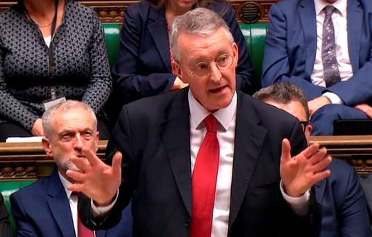 A video grab from footage broadcast by the UK Parliaments Parliamentary Recording Unit (PRU) shows British opposition Labour Party leader Jeremy Corbyn (L) listening as British opposition Labour Party foreign affairs spokesman Hilary Benn addresses the House of Commons ahead of the vote on Syria in London on December 2, 2015.