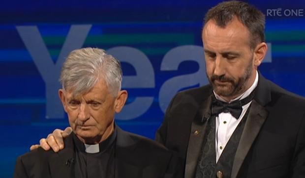 Fr Brendan McBride and Consul General Philip Grant receive their International Award