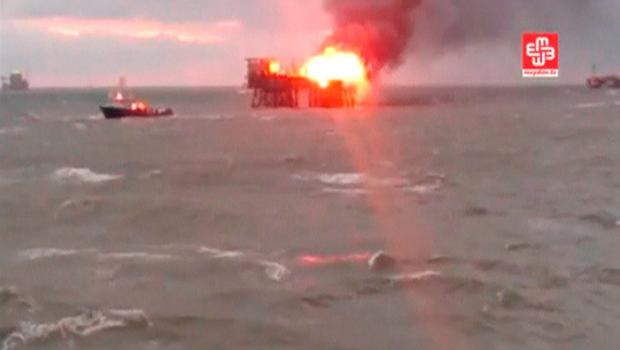 A still image from a video footage shows an oil platform on fire in the Caspian Sea, Azerbaijan, December 5, 2015