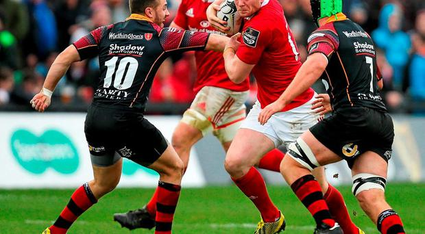 Munster's Denis Hurley in action against Dorian Jones and Nic Cudd at Rodney Parade. Picture credit: Gareth Everett / SPORTSFILE