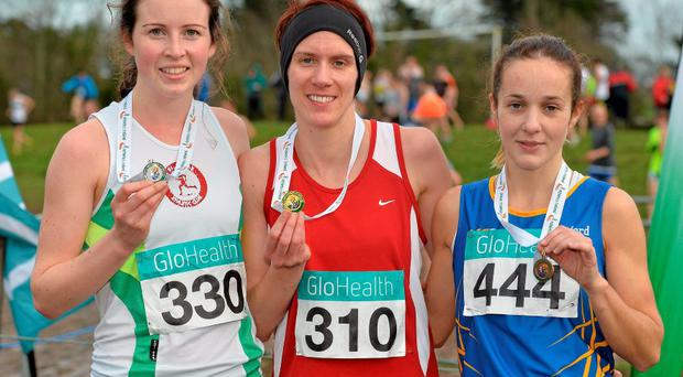 Aoife Cooke, 310, Youghal, Co. Cork, who won the Women's Novice Cross Country with second place Rachel Smyth, left, St Coca's AC, Kilcock, Co. Kildare, and third place Adrianna Melia, right, Longford AC. GloHealth Novice & Uneven Age Cross Country Championships. St.Augustine's College, Dungarvan, Co.Waterford. Picture credit: Matt Browne / SPORTSFILE