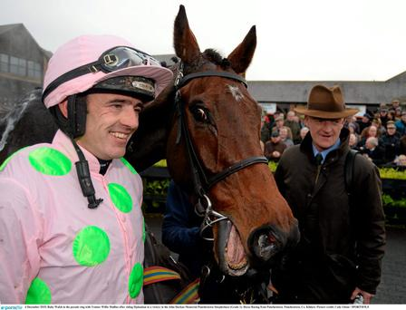Ruby Walsh in the parade ring with Trainer Willie Mullins after riding Djakadam to a victory in the John Durkan Memorial Punchestown Steeplechase