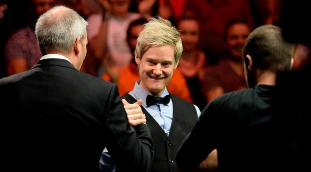 Neil Robertson is congratulated by referee Jan Verhaas after scoring a maximum 147 break in the final match against Liang Wenbo during day twelve of the 2015 Betway UK Snooker Championship at The York Barbican, York.