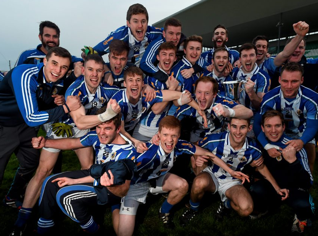 Ballyboden St Enda's players celebrate following their side's victory.
