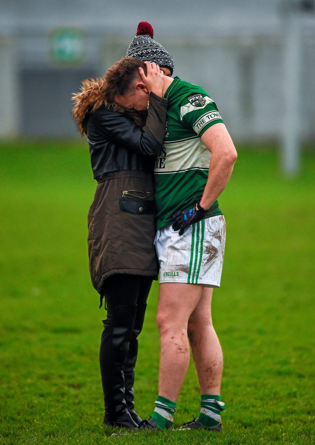Portlaoise's Paul Cahillane, who kicked a late free wide, is comforted after the game by Maeve O'Sullivan. Picture credit: Ray McManus / SPORTSFILE