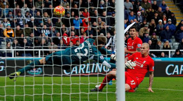 Newcastle United's Georginio Wijnaldum has his shot deflected into the net by Liverpool's Martin Skrtel for an own goal