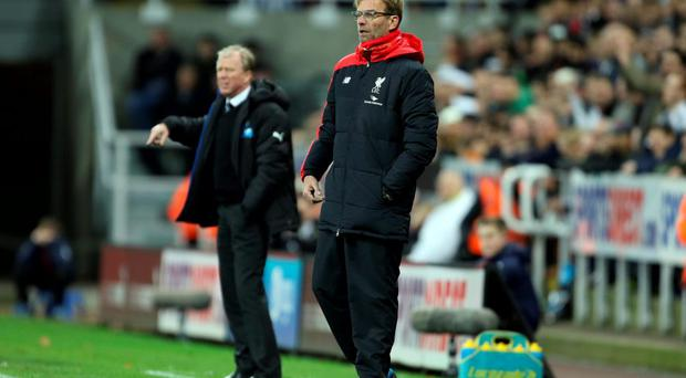 Newcastle United manager Steve McClaren (left) and Liverpool manager Jurgen Klopp during the Barclays Premier League match at St James' Park