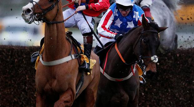 Jamie Moore and Sire De Grugy (left) impede Special Tiara and Noel Fehily as they clear the last in the Betfair Tingle Creek Chase at Sandown.