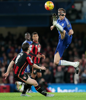 Chelsea's Nemanja Matic soars above Harry Arter to control the ball