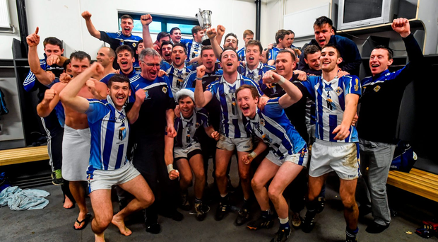 The Ballyboden St Enda's players and management celebrate in the O'Connor Park dressing rooms after the game
