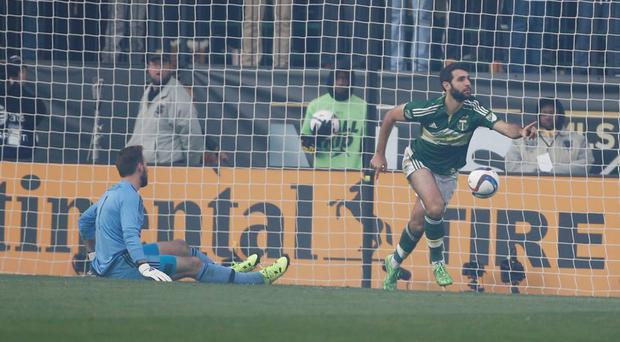 Portland Timbers midfielder Diego Valeri scores a goal against Columbus Crew goalkeeper Steve Clark during the first half in the 2015 MLS Cup championship game at MAPFRE Stadium. Mandatory Credit: Jeff Swinger-USA TODAY Sports