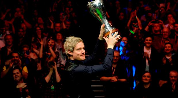 Neil Robertson celebrates with the trophy
