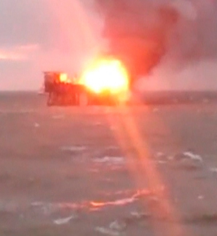 A still image from video footage shows the oil platform on fire in the Caspian Sea, Azerbaijan