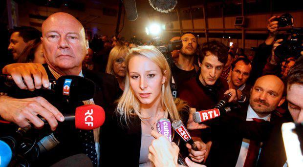 Marion Marechal-Le Pen, French National Front political party member and candidate for National Front in the Provence-Alpes-Cote d'Azur (PACA) region arrives to deliver her speech after the announcement of the results during the first round of the regional elections in Le Pontet, near Avignon, France, December 6, 2015