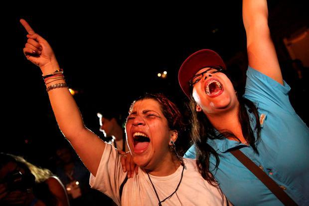 Supporters of the opposition Democratic Unity coalition shout while they celebrate their victory on a street in Caracas December 7, 2015