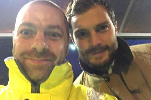 Jamie Dornan with Belfast City worker Gary Ross