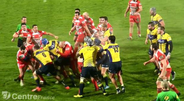 Opposition players exchange punches