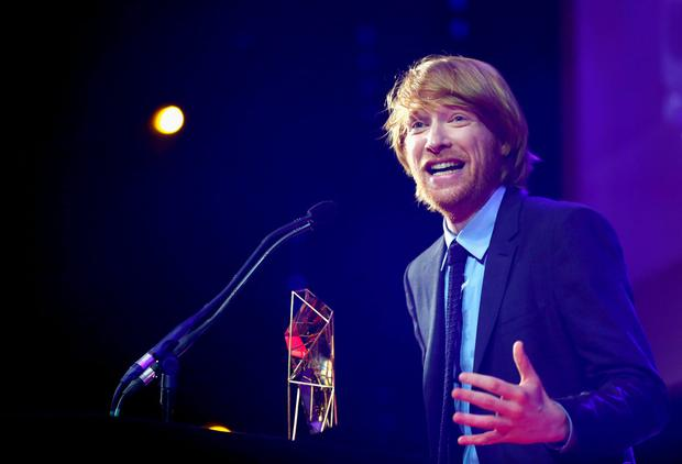 LONDON, ENGLAND - DECEMBER 06: Actor Domhnall Gleeson accepts the award for Best Supporting Actor on behalf of his father Brendan Gleeson at The Moet British Independent Film Awards 2015 on December 6, 2015 in London, United Kingdom. (Photo by Tristan Fewings/Getty Images for The Moet British Independent Film Awards)