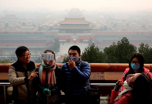 Smog shrouded the capital city Monday after authorities in Beijing issued an orange alert on Saturday. (AP Photo/Andy Wong)