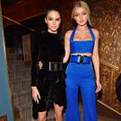 Gigi Hadid and Kendall Jenner attend the Balmain Aftershow Dinner as part of the Paris Fashion Week Womenswear Fall/Winter 2015/2016 on March 5, 2015 in Paris, France. (Photo by Jacopo Raule/Getty Images For Balmain)