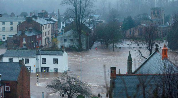Roads have been closed throughout the North and Scotland as Storm Desmond caused road chaos, landslides and flooding