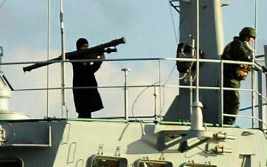 NTV news channel has broadcast photographs that it said showed a serviceman brandishing a rocket launcher on the deck of the landing ship Caesar Kunikov