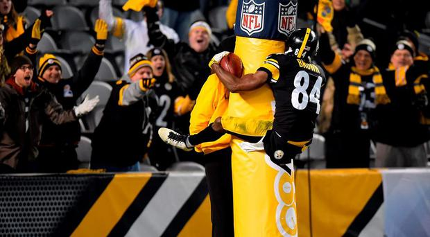 Antonio Brown #84 of the Pittsburgh Steelers celebrates a fourth quarter touchdown by jumping on the goal post during the game against the Indianapolis Colts at Heinz Field in Pittsburgh, Pennsylvania. (Photo by Joe Sargent/Getty Images)