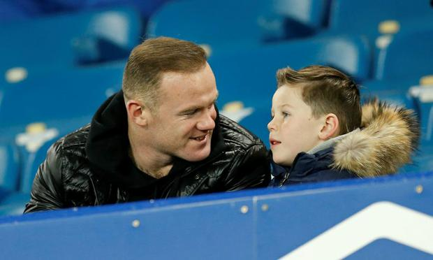Manchester United's Wayne Rooney with son Kai sat in the stands