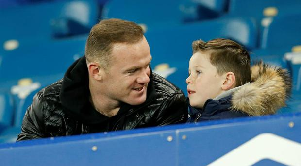 Manchester United's Wayne Rooney with son Kai made a young fan's dream come true