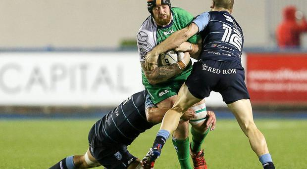 Aly Muldowney runs into trouble in Cardiff duo Jarrod Hoeata and Gavin Evans at the Arms Park. But Connacht can still take heart from their display