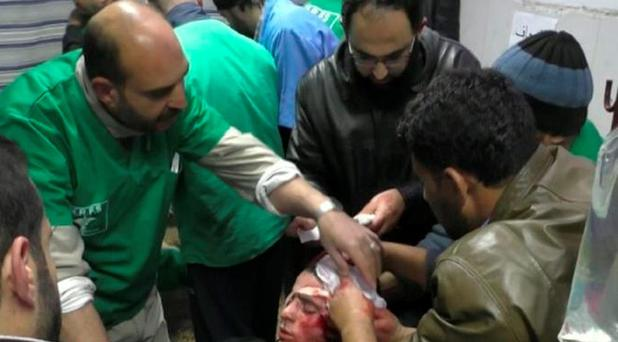 An image of Ibrahim Zakaria being treated after he was wounded