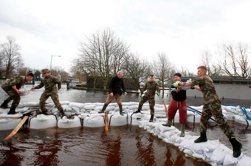 The 2nd army battalion works in Ballinasloe, Co Galway, to hold back rapidly rising waters in the wake of Storm Desmond