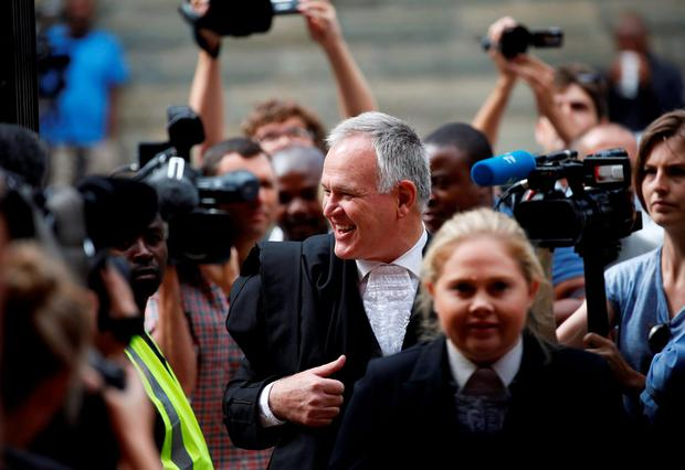 Oscar Pistorius' defence advocate Barry Roux arrives at the North Gauteng High Court in Pretoria, South Africa for a bail hearing, December 8, 2015