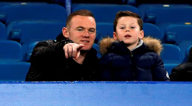 Manchester United's Wayne Rooney with his son Kai during the Barclays Premier League match at Goodison Park last night