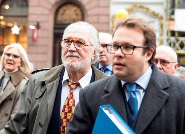 Former Radio 1 DJ Dave Lee Travis (left) arrives at the Royal Courts of Justice in London to challenge his indecent assault conviction