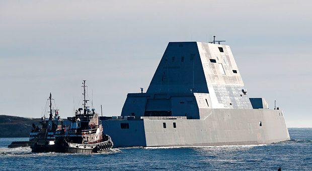 The first Zumwalt-class destroyer, the USS Zumwalt , the largest ever built for the U.S. Navy, leaves the Kennebec River in Phippsburg, Maine